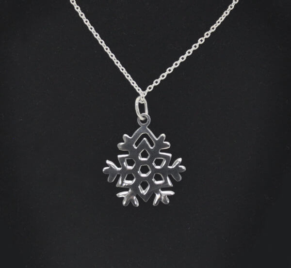 sterling silver Chrsterling silver lace snowflake pendant and chain on black jewelry neck
