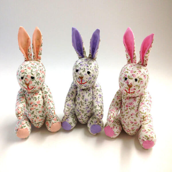 trio of Pocket Pal® bunnies in petite floral pastel patterns - peach, lavender and pink