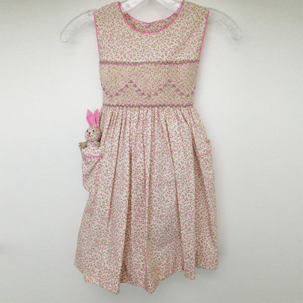 pink petite floral pattern hand smocked dress - sleeveless with pink piping - matching Pocket Pal® bunny in the pocket