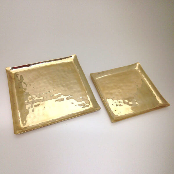 two sizes of square hand hammered bronze tableware