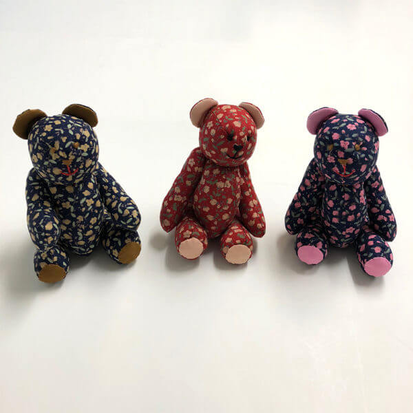 trio of Petite floral pattern Pocket Pal® bears