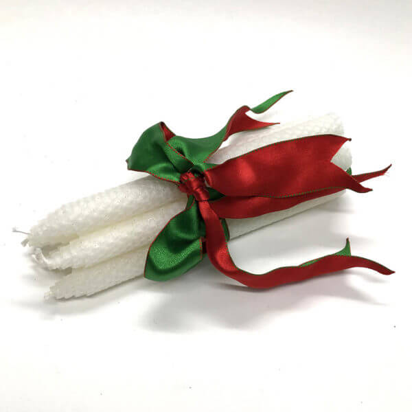bundle of white beeswax holiday candles