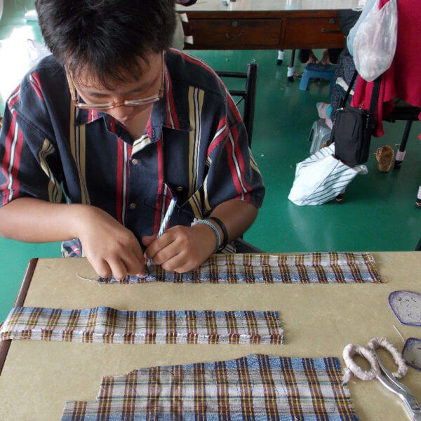 Cutting out Plaid Lad pattern pieces