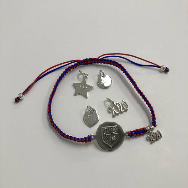 Spirit bracelet with mini grad year charm and four other grad charm options: star, round, heart, and large grad year.