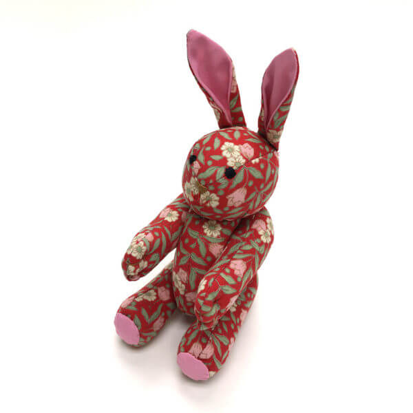 Small pocket pal® bunny made of bright red floral print cotton