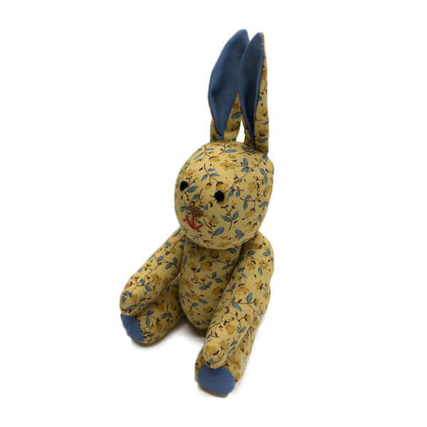 Small cotton pocket pal® bunny of gold floral material