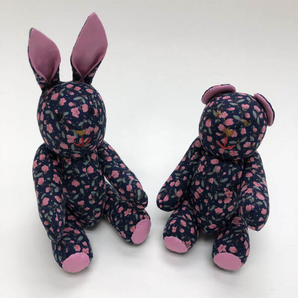 Pink on navy floral pocket pals® - bunny and bear
