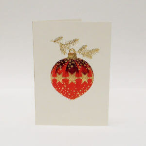Paula Skene Designs gold snowflake on red ornament on ecru Christmas card