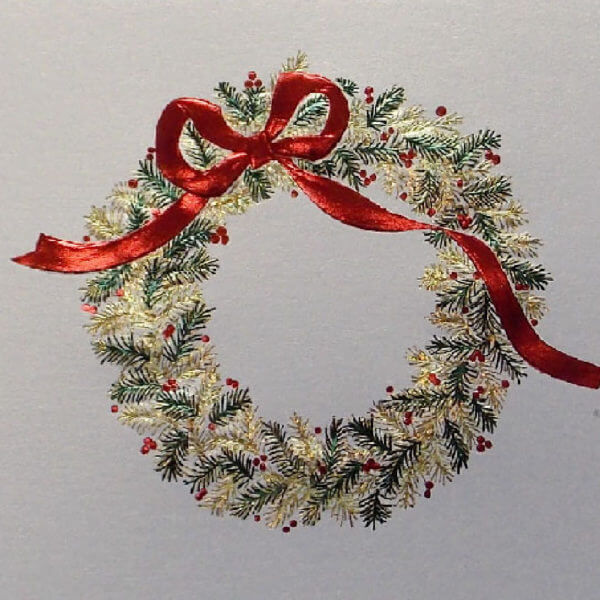 green and gold wreath with red bow closeup 1000 pixels