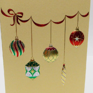 Paula Skene Designs hanging ornaments on gold Christmas card