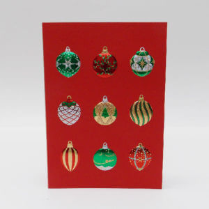 Paula Skene Designs Christmas card with foil embossed ornaments on a red card