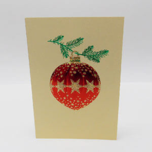 Paula Skene Designs red and gold snowflake ornament on gold Christmas card