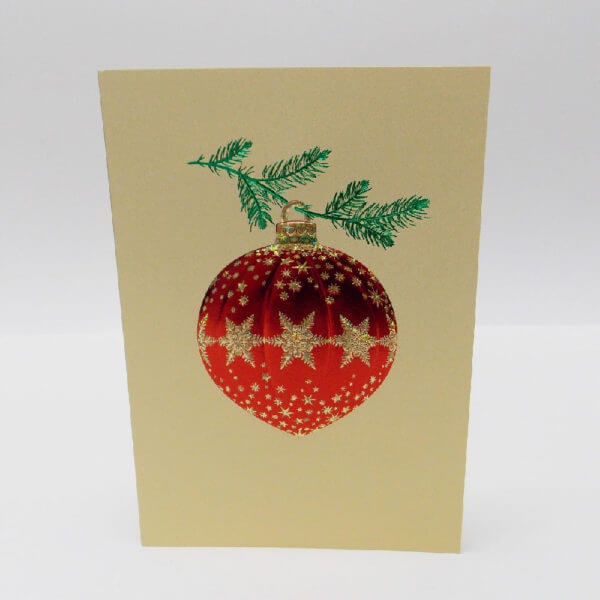 red ornament on gold card 1000 pixels