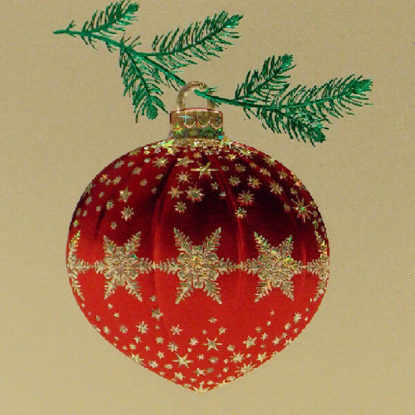 red ornament on gold card closeup 1000 pixels