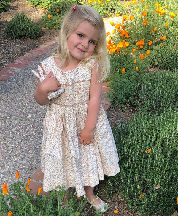 Hand smocked peaches and cream floral dress